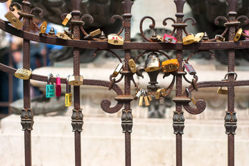 Padlocks on the fence of Pontevecchio bridge in Florence, Italy symbolizing everlasting love