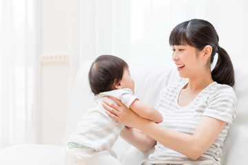 portrait of asian baby and mother relaxing