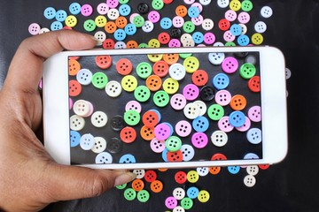 Taking a photo of sewing buttons with smart phone