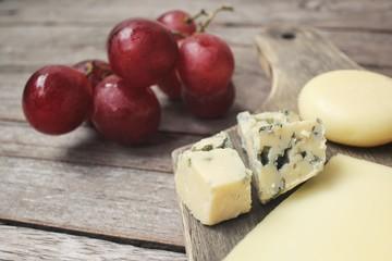 Cheese various and grapes