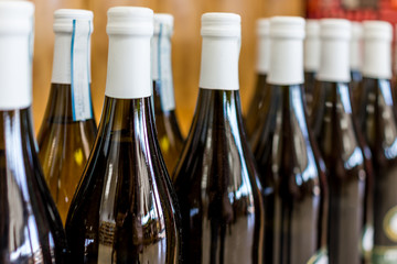 Row of wine bottles on display for sale