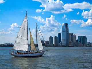 City and a Sail Boat