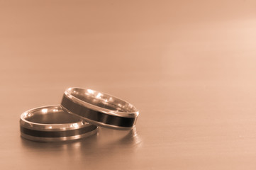 Two rings on the table for valentine day,Sepia color