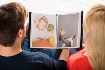 Young Couple Looking At Photo Album