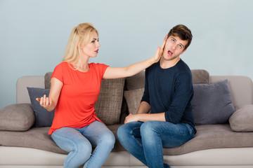Woman Slapping Man While Quarreling At Home