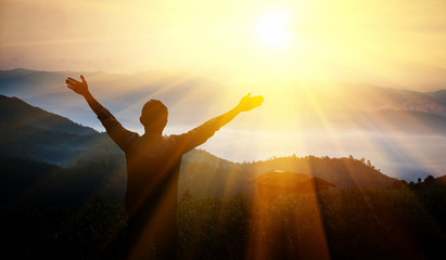 Man thanks God on  mountain.