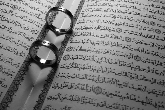 wedding rings with background holy quran