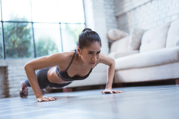 """Asian women exercise indoor at home she is acted """"push up"""""""