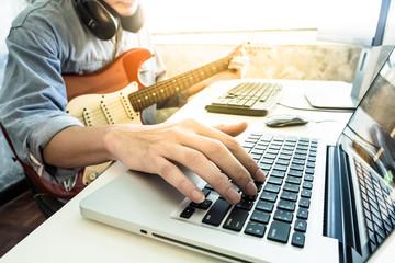 Professional musician recording electric guitar in digital studio