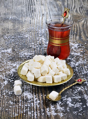 dried coconut  and tea on wooden table