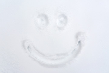 smiley drawing on snow surface
