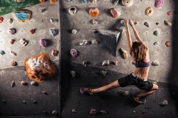 woman practicing rock-climbing