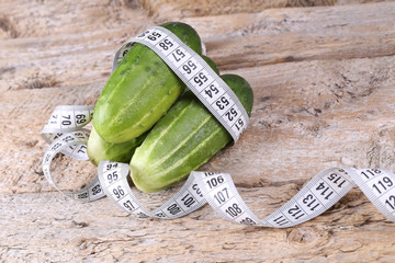 Cucumbers for making dietary salad. Weight Loss Concept. Diet food.