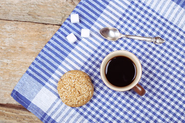 Coffee, sugar and cookie on the table