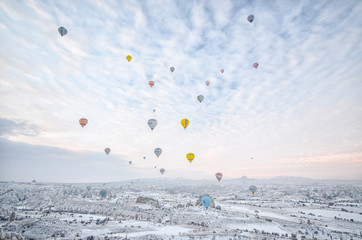 Group of Hot Air Balloons Flying Over Cappadocia During Sunrise