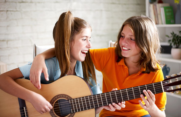 Teenagers playing guitar