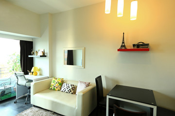 Interior design of room with furniture. Comfortable with bed, sofa,  chairs, standing lamp, small table