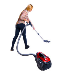 Rear view of a woman with a vacuum cleaner. She is busy cleaning.