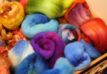 soft balls of colored wool to create winter sweaters