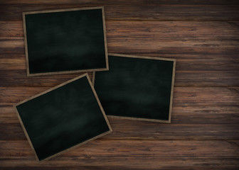 Clean chalk board on wooden wall for background.texture for educational or business background.