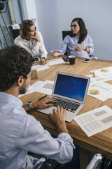 Young team of coworkers doing a meeting in a modern studio