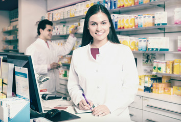 pharmacist standing at pay desk