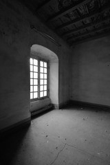 old abandoned room with window - black and white