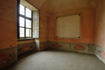 old abandoned orange room with window