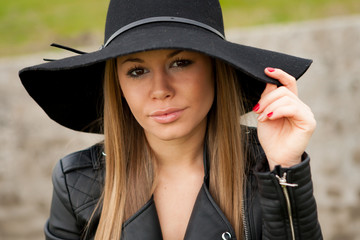Stylish young woman with beautiful hat