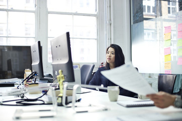 Young asian woman at an office desk