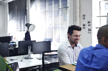 Caucasian businessman in a contemporary office with colleagues