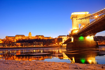 The Chain Bridge and the Royal Palace at sunset over the icy Dan