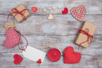 Gifts, hearts, bows and ornaments on wooden table. Valentines Day