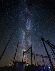 Milky way and starry sky over the power line.