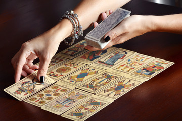 Placing tarot cards on table