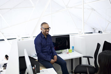 Mixed race male creative professional in loft style contemporary office