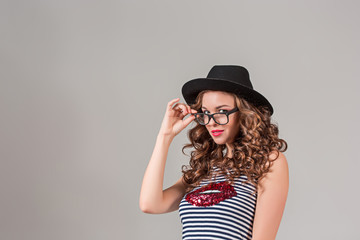girl in glasses and hat