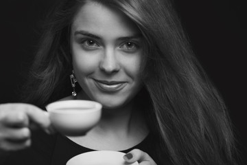 portrait of a female with a cup of coffee