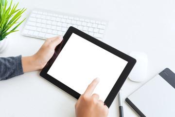 hand using digital tablet finger touch blank screen on desk work