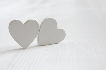 Couple of hearts on wooden table