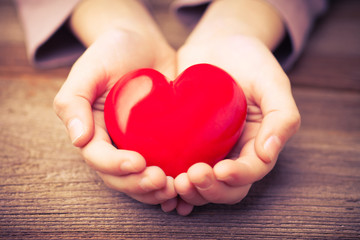 hands protect a heart