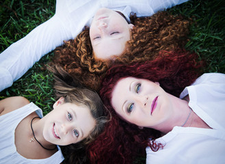 Red-haired mother and her two daughters