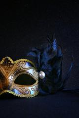 Image of black elegant venetian mask on glitter background