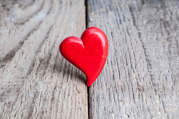 Heart on grunge wooden background. Valentines day card