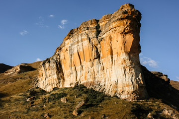 Brandwag rock, scenic cliffs illuminated by warm late afternoon light, Golden Gate Highlands National Park, South Africa