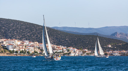 Wall Mural - Yachts at Sailing regatta at the Aegean Sea near the Greek Islands. Luxury boats.