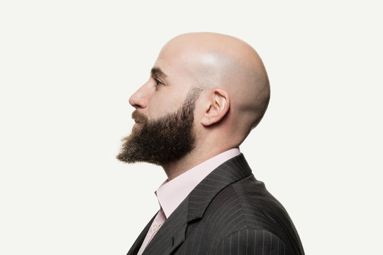 Young bald man with a beard