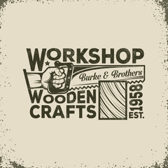 Workshop of the Joiner or Carpenter Vintage Logo - Hand Holding a Saw and Sawing of Wood. Vector illustration - worn texture and background on separate layers, can disable, easy to edit.