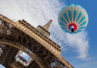 Hot air balloon flying over Eiffel tower - Paris, France