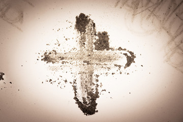 Cross made of ashes, purple Lent season background